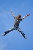 Jumping adolescent Stock Images