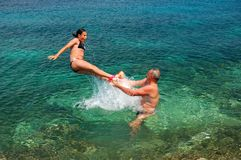 Jumping into adriatic water Royalty Free Stock Photo
