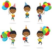 Jumping African-American boys carrying colorful wrapped gift box Royalty Free Stock Images