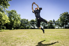Jumping American Football Player Stock Photos