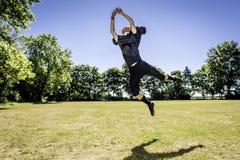 Jumping American Football Player stock photos