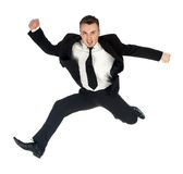 Jumping angry businessman Stock Image