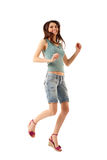 Jumping attractive happy teen girl Royalty Free Stock Photography