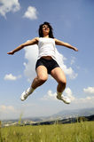 Jumping attractive women in meadow Royalty Free Stock Images