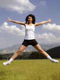 Jumping attractive women in meadow Royalty Free Stock Photo