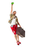 Jumping away. A young, attractive male in a colorful outfit ready to travel as a stereotype tourist Stock Photography