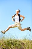 Jumping with backpack Royalty Free Stock Photos