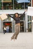 Jumping with bag Royalty Free Stock Photography