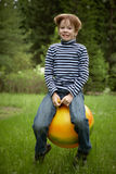 Jumping on the ball Royalty Free Stock Images