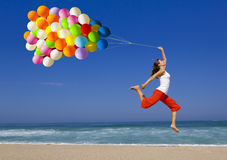 Jumping with balloons Stock Images