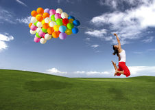 Jumping with balloons stock photo