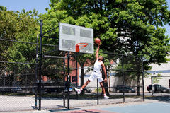 Jumping basketball player Stock Image