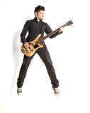 Jumping bass player on a white background. Super star Royalty Free Stock Image