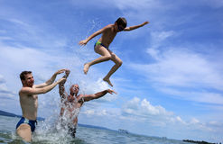 Jumping at the beach Royalty Free Stock Photography