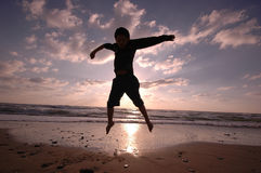 Jumping on the beach Stock Image