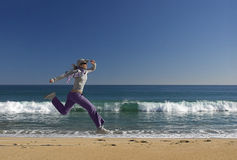 Jumping on the beach royalty free stock images