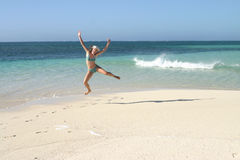 Jumping on a beach Stock Photography