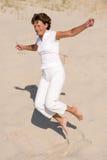 Jumping at the beach Royalty Free Stock Photo