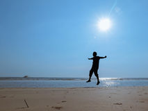 Jumping on the beach Royalty Free Stock Photography