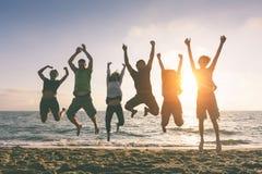 Jumping at Beach Royalty Free Stock Images
