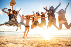 Jumping at the beach. Summer, holidays, vacation, happy people concept Royalty Free Stock Photography