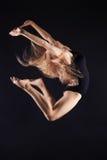 Jumping beautiful gymnast girl.beauty ballet woman Stock Photos