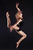 Jumping beautiful gymnast girl.beauty ballet woman Stock Photography