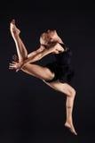 Jumping beautiful gymnast girl.beauty ballet woman Royalty Free Stock Photo