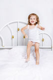 Jumping in bed Royalty Free Stock Image