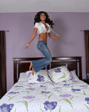 Jumping on the bed Stock Images