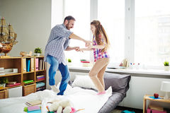 Jumping on bed with dad Royalty Free Stock Photography
