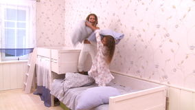 Jumping on the bed. HD 1080p - Cute little girls have fun jumping on their bed stock video footage