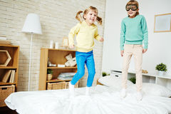 Jumping on bed Royalty Free Stock Image