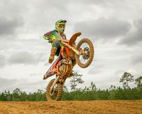 Motocross action scene - Wheel up. Motorcross first evolved in the U.K. from motorcycle trials competitions, such as the Auto-Cycle Clubs`s first quarterly trial royalty free stock photo