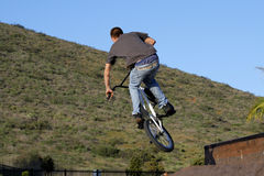 Jumping bicyclist Stock Photo