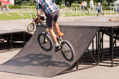 Jumping on the bike. In the city with obstacles Royalty Free Stock Photo