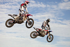Jumping Bikes at Supercross Royalty Free Stock Photo