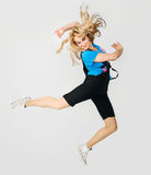 Jumping blond girl Royalty Free Stock Photos