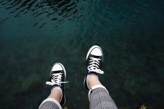 Jumping into the blue sea stock photos