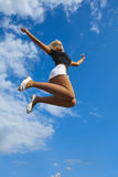 Jumping on blue sky Royalty Free Stock Photo