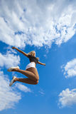 Jumping on blue sky Royalty Free Stock Photos