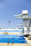 Diving board in outdoor swimming pool Stock Photos