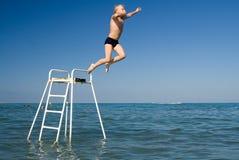 Jumping boy Stock Photos
