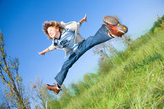 Jumping boy. Happy jumping boy. blue sky Stock Photography