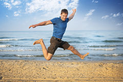 Jumping boy beach Stock Images