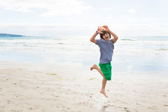 Jumping boy on the beach Royalty Free Stock Image