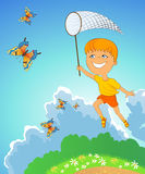 Jumping boy with butterfly Stock Photo