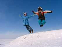 Jumping boy and girl Stock Images