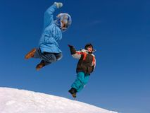 Jumping boy and girl Royalty Free Stock Photos