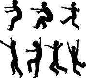 Jumping Boy Silhouettes Stock Images